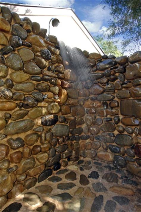River stone outdoor shower | Solid Stone Constructions